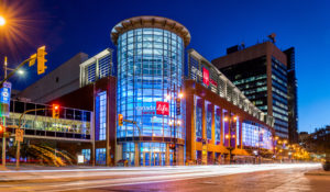 A photo of the Canada Life Centre at night.